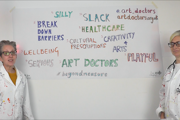 Art doctors with creative words and a flashy stick